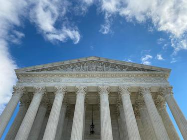 U.S. Supreme Court hears first case by teleconference; Thomas asks questions